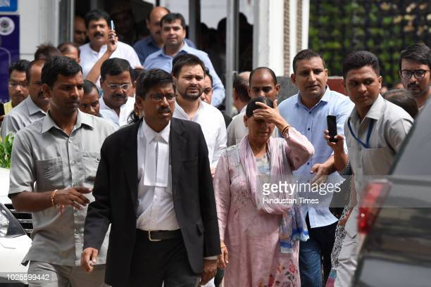 Rabri Devi, wife of RJD Chief and former Railway Minister Lalu Prasad Yadav and her son Tejaswi Yadav leave Patiala House Court for hearing in IRCTC...