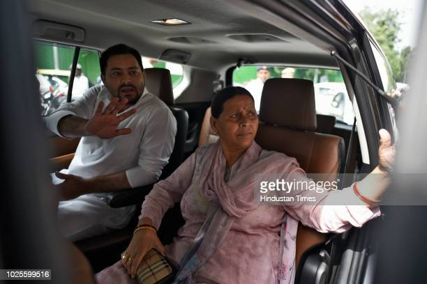 Rabri Devi, wife of RJD Chief and former Railway Minister Lalu Prasad Yadav and her son Tejaswi Yadav arrive at Patiala House Court for hearing in...