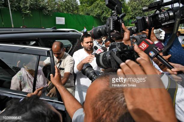 Rabri Devi , wife of RJD Chief and former Railway Minister Lalu Prasad Yadav and her son Tejaswi Yadav arrive at Patiala House Court for hearing in...