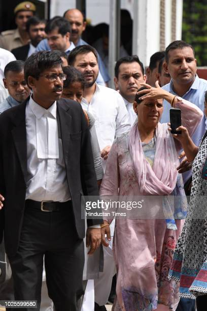 Rabri Devi, wife of RJD Chief and former Railway Minister Lalu Prasad Yadav and her younger son Tejashwi Yadav leave Patiala House Court for hearing...