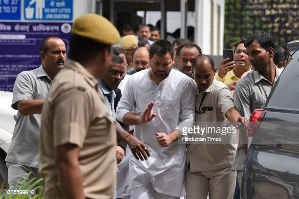 Rabri Devi , wife of RJD Chief and former Railway Minister Lalu Prasad Yadav and her son Tejaswi Yadav leave Patiala House Court for hearing in IRCTC...