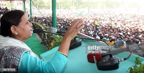 Rabri Devi wife of RJD Chief Lalu Prasad Yadav addressing Parivartan Rally at Gandhi Maidan on May 15 2013 in Patna India Addressing his first major...