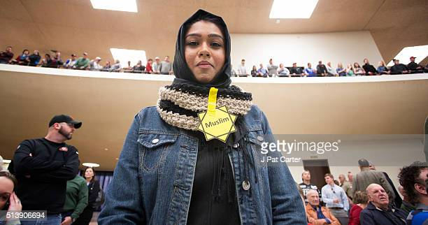 Rabya Ahmed listens as Republican presidential candidate Donald Trump makes a speech at a campaign rally on March 5 2016 in Wichita Kansas where the...
