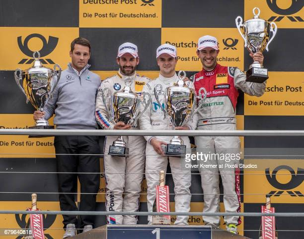Race 1 Winner Lucas Auer of MercedesAMG DTM Team Muecke with second placed Timo Glock of BMW M4 Team RMG and third placed Mike Rockenfeller of Audi...
