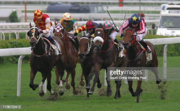 Race 2 No 5 Wealthy Treasure ridden by Shane Dye wins the 1400m race at Sha Tin Racecourse 18 May 2003