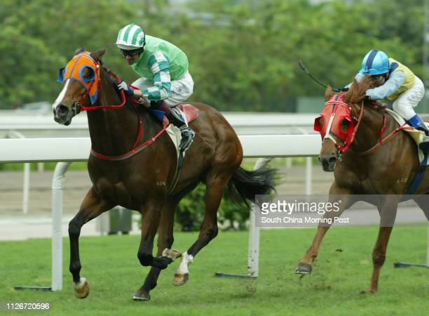 Race 4 No 10 Congee King ridden by Dwayne Dunn wins the 1400m race at Sha Tin Racecourse 18 May 2003