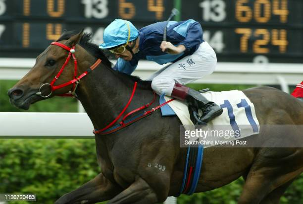 Race 6 No 11 Solar Empire ridden by Michael Cahill wins the 1400m race at Sha Tin Racecourse 18 May 2003