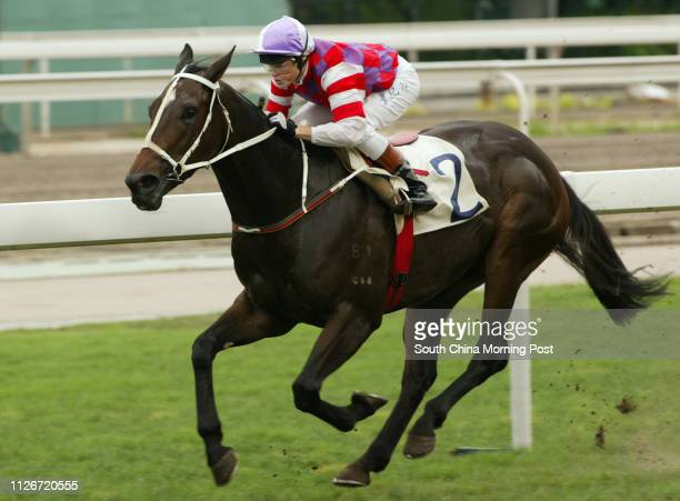 Race 7 No 2 Cheerful Fortune ridden by Craig Williams wins the 1200m race at Sha Tin Racecourse 18 May 2003