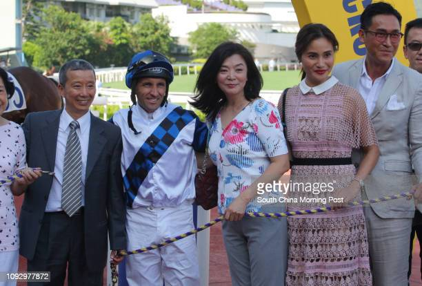 Race 7 trainer Benno Yung Tinpang with jockey Neil Callan won the Hong Kong Riding for the Disabled Association Cup at Sha Tin Picture shows coonwers...