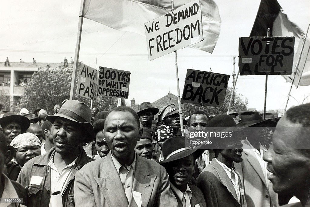 Race. Apartheid. South Africa. pic: 1952. Black African protesters seen among a crowd at a Johannesburg protest meeting which defied a ban on such gatherings. : News Photo