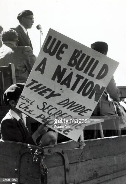 1952 Typical antiapartheid slogan as non white protesters part of a large crowd at a Capetown protest meeting which called for freedom and equality