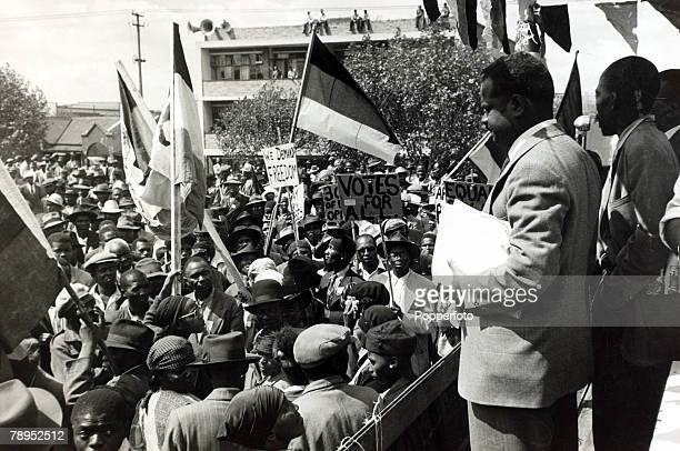 May 1952 Non white protesters calling for votes and freedom at a protest meeting in Johannesburg which defied a ban on such gatherings