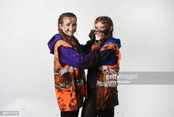 Race assistants in the the annual McVities Mud Madness 8km cross country run pose for a portrait in a pop up photo booth on April 9, 2017 in...