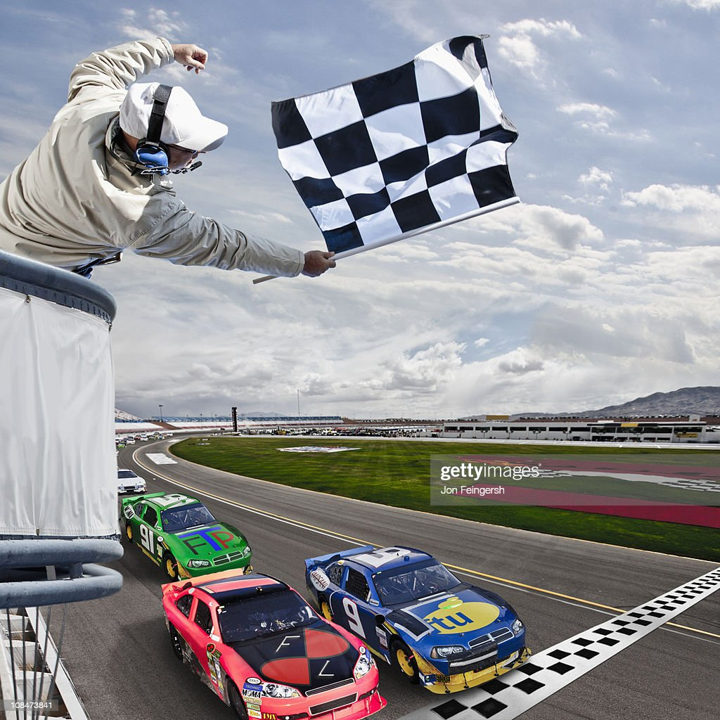 Race car crossing the finish line : Stock Photo