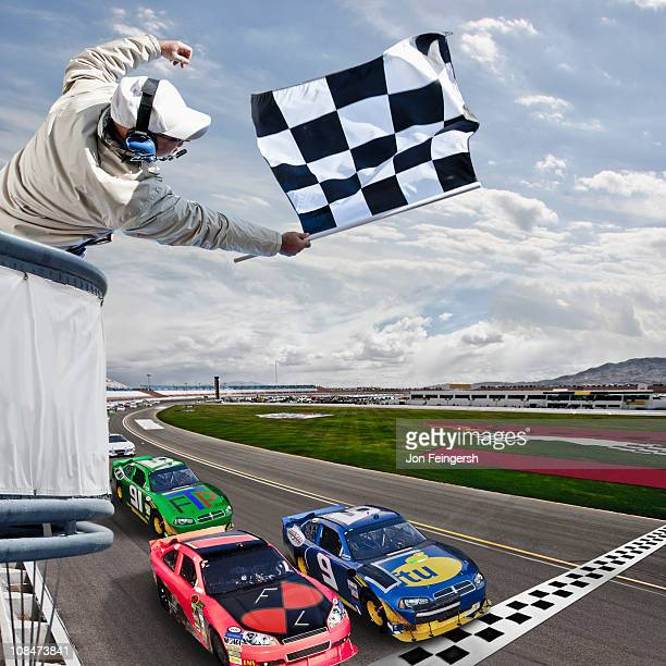 race car crossing the finish line - nascar stock pictures, royalty-free photos & images