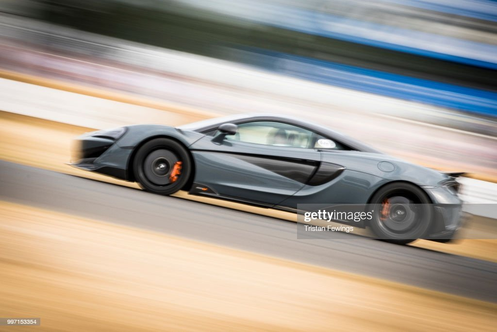 A race car does a lap of the race course during the Goodwood Festival Of Speed at Goodwood on July 12, 2018 in Chichester, England.