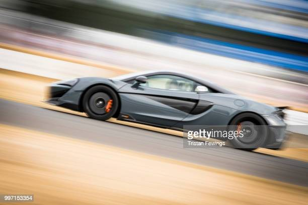 A race car does a lap of the race course during the Goodwood Festival Of Speed at Goodwood on July 12 2018 in Chichester England