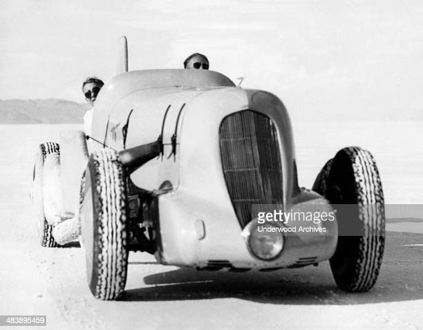 Race car driver Ab Jenkins as he starts our on a test run in his attempt to set new land speed records in his 700 horsepower race car Bonneville Salt...