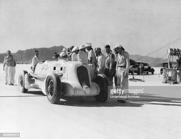 Race car driver Ab Jenkins at the end of his 24 hour speed record where he set a new average speed mark of 13547 mph Bonneville Salt Flats Utah...