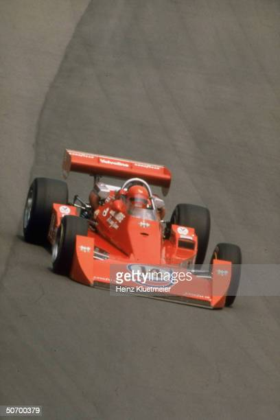 Race car driver A.J. Foyt finishing lap en route to becoming 1st 4-time Indianapolis 500 winner