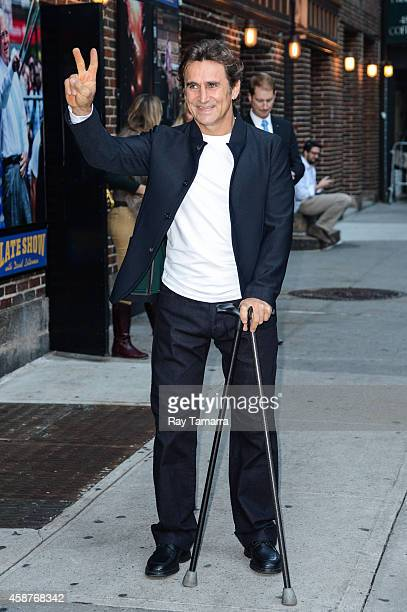 Race car driver Alex Zanardi enters the 'Late Show With David Letterman' taping at the Ed Sullivan Theater on November 5 2014 in New York City