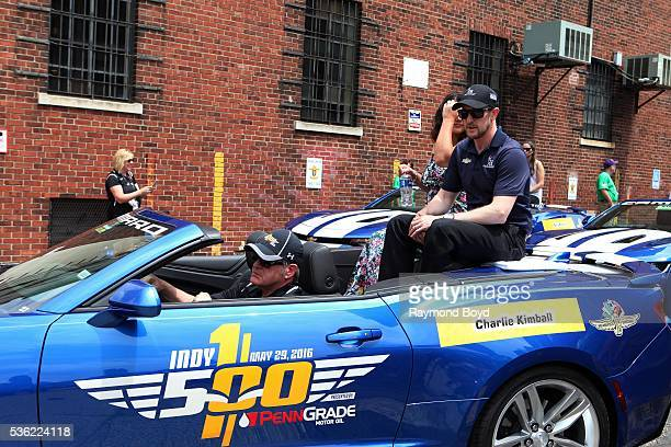 Race car driver Charlie Kimball makes his way South on Pennsylvania Street during the Indianapolis 500 Festival Parade in downtown Indianapolis...