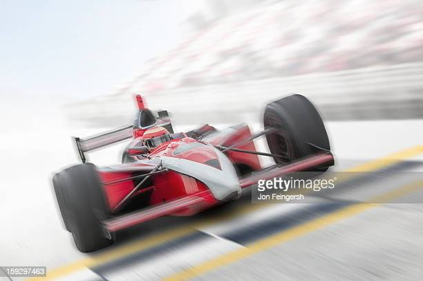 INDY race car driver crossing finish line.