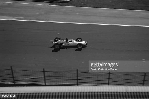 Race car driver Dan Gurney driving car 91, a Lotus powered by a Ford engine, during a qualifying lap for the Indianapolis 500 race at Indianapolis...