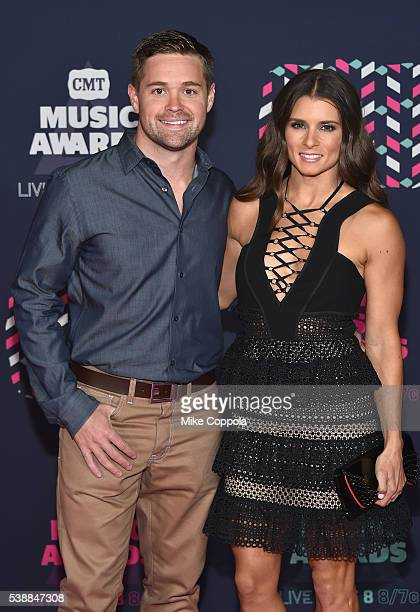 Race car driver Danica Patrick and race car driver Ricky Stenhouse Jr attends the 2016 CMT Music awards at the Bridgestone Arena on June 8 2016 in...