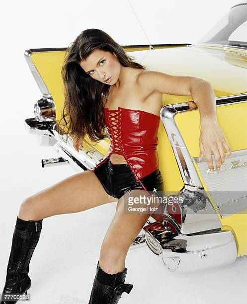 Race car driver Danica Patrick is photographed for FHM on October 9 2002 at Fast Ashley's in Brooklyn New York