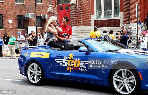 Race car driver Graham Rahal makes his way South on Pennsylvania Street during the Indianapolis 500 Festival Parade in downtown Indianapolis Indiana...