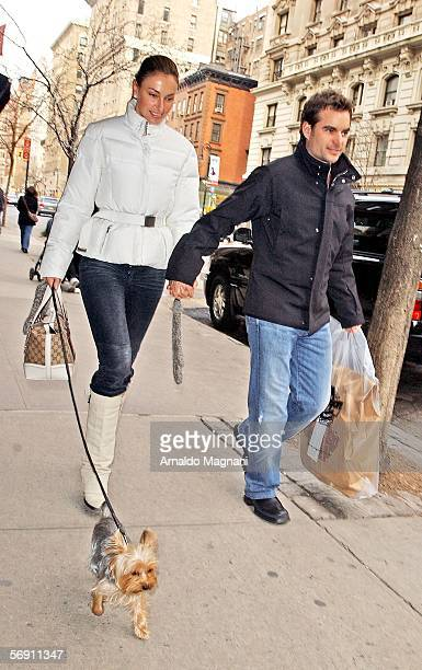 Race car driver Jeff Gordon and companion Ingrid Vanderbosch hold hands as they walk her dog Valentino after having lunch at Nello's February 22 2006...