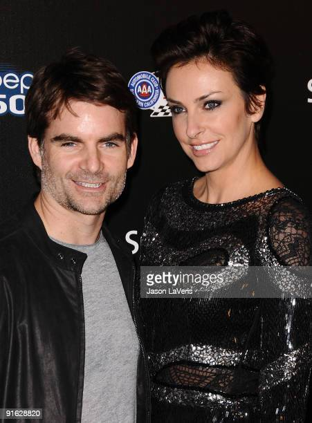 Race car driver Jeff Gordon and wife Ingrid Vandebosch attend Auto Club Speedway's Pepsi 500 at The Roosevelt Hotel on October 7 2009 in Hollywood...