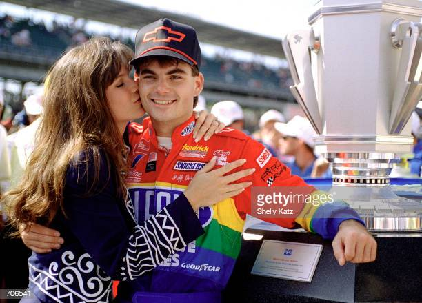 Race car driver Jeff Gordon receives a congratulatory kiss from fiance Brooke after winning the inaugural Brickyard 400 NASCAR race at Indianapolis...