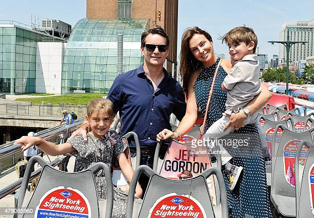 Race Car Driver Jeff Gordon with wife Ingrid Vandebosch and children Ella and Leo pose during Jeff Gordon Honored By Ride Of Fame at Pier 78 on June...
