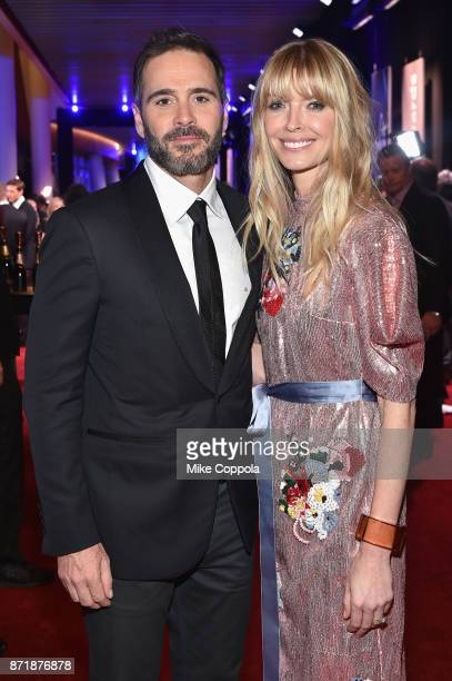 Race car driver Jimmie Johnson poses with Moet Chandon during the 51st Annual CMA Awards at Bridgestone Arena on November 8 2017 in Nashville...