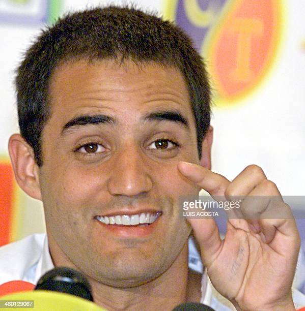 Race car driver Juan Pablo Montoya smiles during a press conference in Bogotal Colombia 25 March 2002 El piloto de Formula 1 Juan Pablo Montoya...