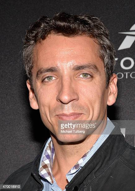 Race car driver Justin Wilson attends a charity screening of the film 'WINNING The Racing Life Of Paul Newman' at the El Capitan Theatre on April 16...