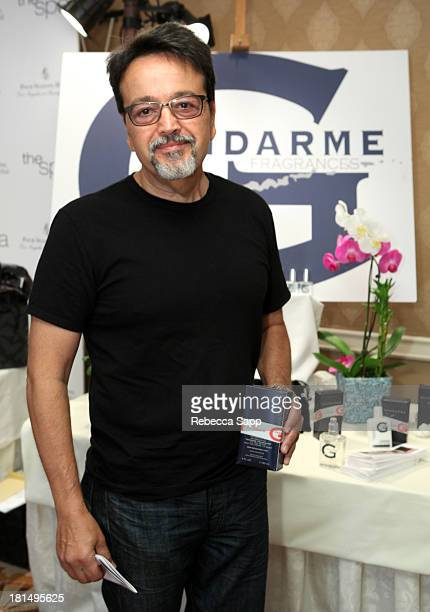 Race car driver Len Amato attends the HBO Luxury Lounge featuring Motorola and PANDORA Jewelry in honor of The 65th Primetime Emmy Awards at The Four...