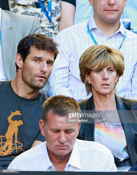 Race car driver Mark Webber and Ann Neal look on in the men's final match between Rafael Nadal of Spain and Stanislas Wawrinka of Switzerland during...