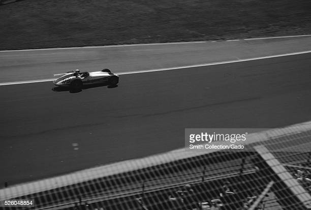 Race car driver Parnelli Jones driving car 98 made by the Watson car company with an engine from Offy during a qualifying lap for the Indianapolis...
