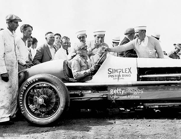 Race car driver Ray Keech in his Simplex Piston Ring Special race car after winning the Indy 500 Indianapolis Indiana 1929