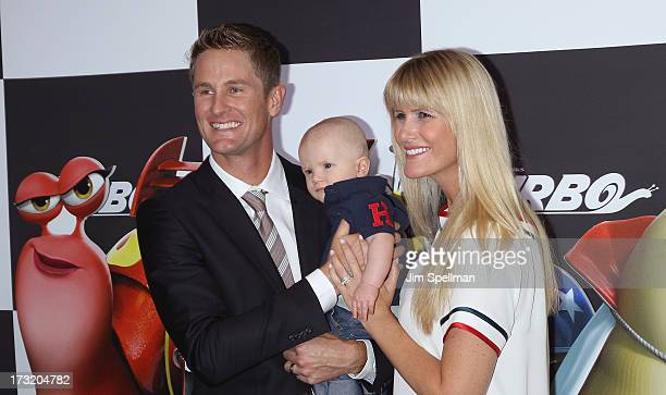 """Race Car Driver Ryan Hunter-Reay with son Ryden and wife Beccy Gordon attend the """"Turbo"""" New York Premiere at AMC Loews Lincoln Square on July 9,..."""