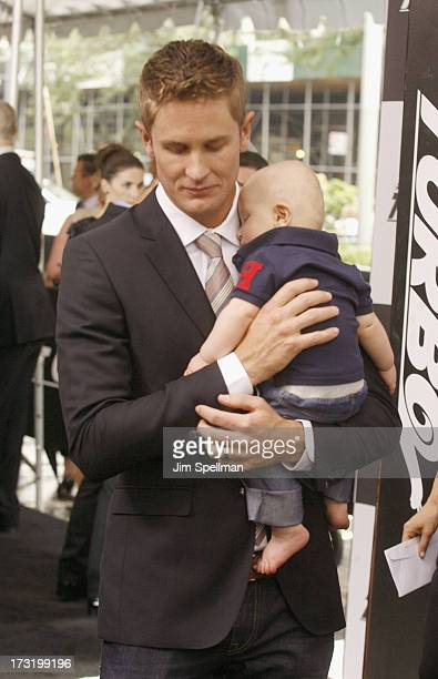 """Race Car Driver Ryan Hunter-Reay with son Ryden attend the """"Turbo"""" New York Premiere at AMC Loews Lincoln Square on July 9, 2013 in New York City."""