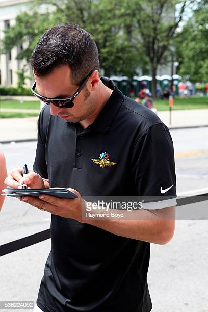 Race car driver Sam Hornish Jr greets fans outside the Indianapolis Central Library during the Indianapolis 500 Festival Parade in downtown...