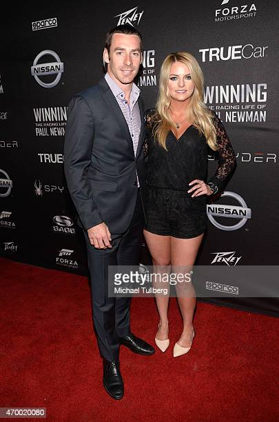 Race car driver Simon Pagenaud and Hailey McDermott attend a charity screening of the film WINNING The Racing Life Of Paul Newman at the El Capitan...