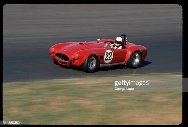 A race car driver takes a Cobra 427 racecar around the track at Sears Point International Raceway in California | Location Sears Point International...