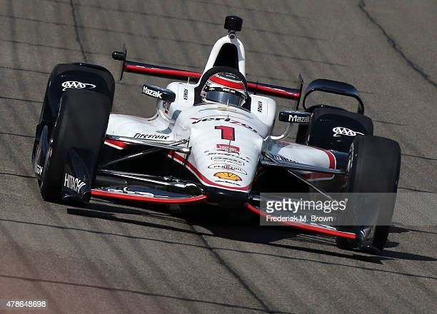 Race car driver Will Power on the track during practice session at the Auto Club Speedway on June 26, 2015 in Fontana, California.