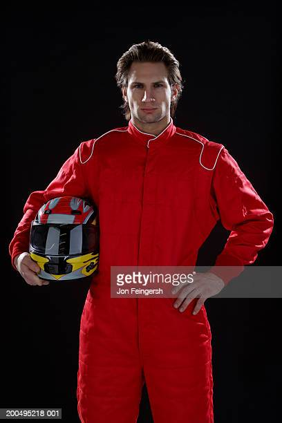 Race car driver with helmet, portrait