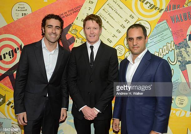 Race car drivers Dario Franchitti Scott Dixon and Juan Pablo Montoya attend the celebration of Target's 50th Anniversary on October 16 2012 in New...